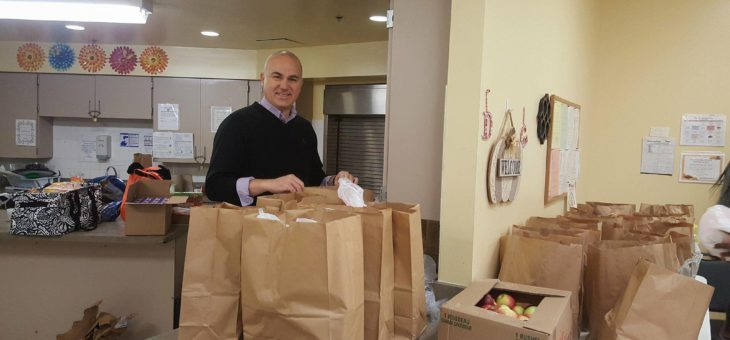 President of IUBCCI helping in making Thanksgiving bags of food for poor families